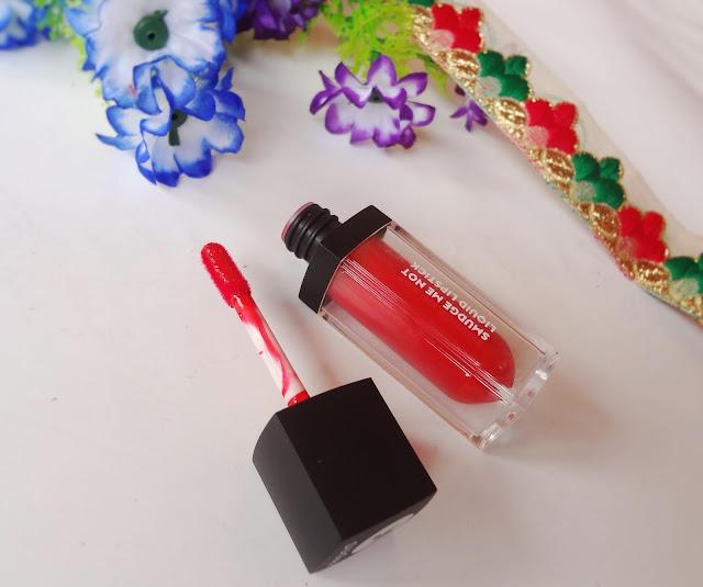 Sugar smudge me not liquid lipstick in 06 Tangerine Queen