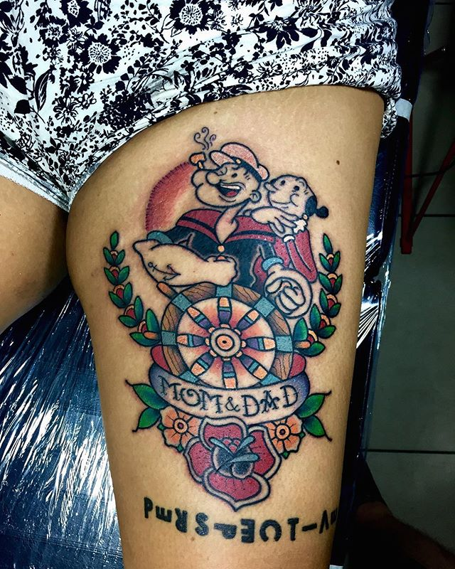 popeye tattoo on thigh