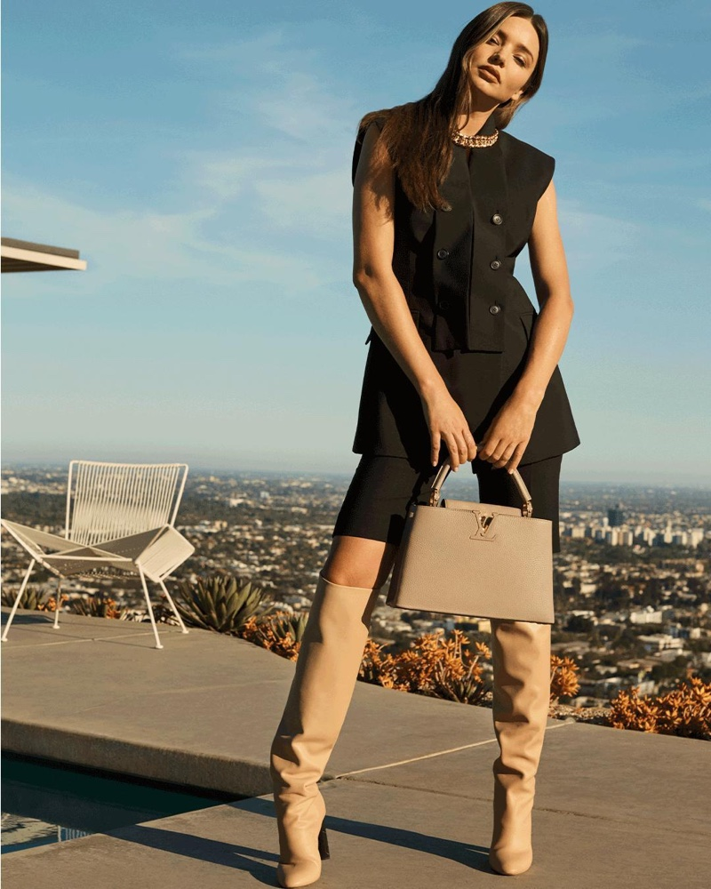 Model Miranda Kerr poses with Louis Vuitton Capucines MM bag in new campaign.