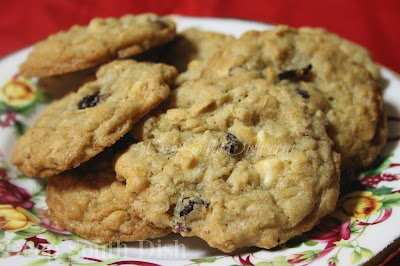 Chewy oatmeal cookies, with dried cranberries and white chocolate chips scattered throughout!
