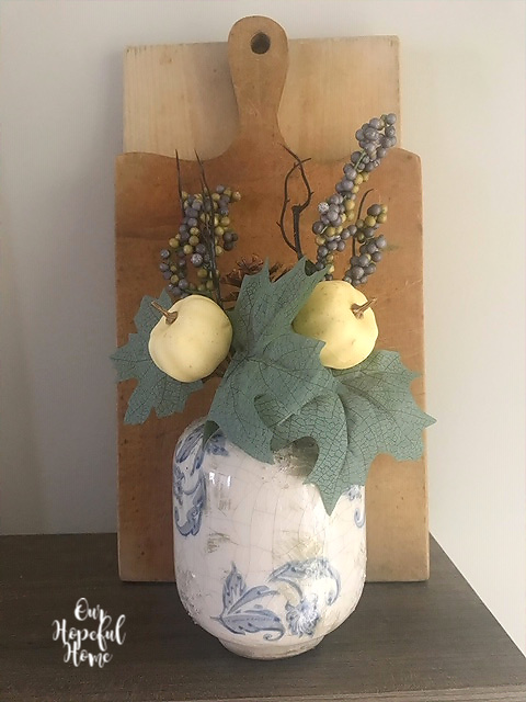 vintage inspired vase faux berry picks cutting board