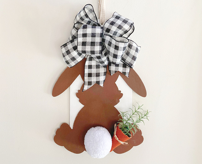 Brown bunny with buffalo checked bow, a bunny tail and a carrot