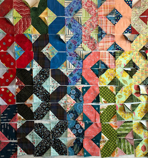 Swapping beige blocks for yellow and moving the light green blocks to the right looks better but makes a sharp value division through the middle of the quilt