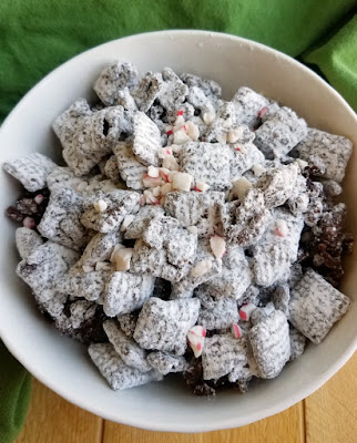 "bowl of dark chocolate and peppermint ""reindeer"" puppy chow"