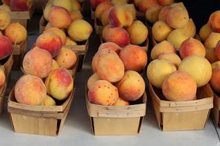 Baskets on fresh peaches at a local farmer's market