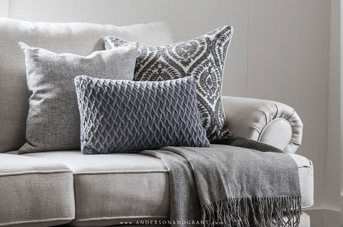 Pillows and throw on sofa