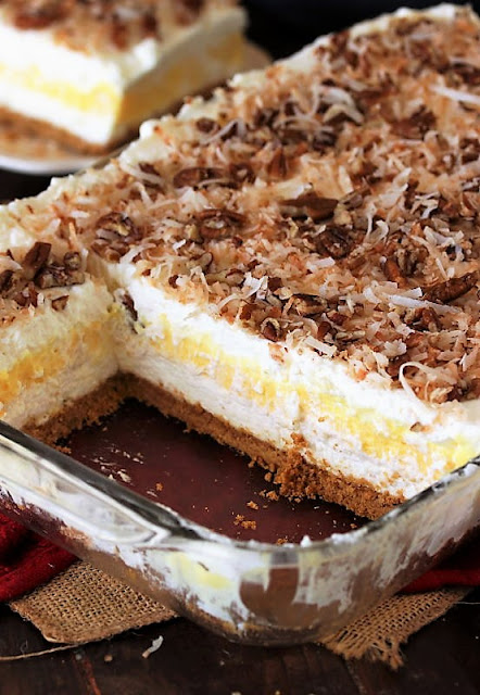Coconut Cream Yum Yum in Baking Dish Cut to Show Layers Image