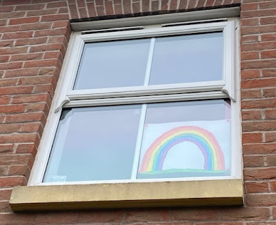 Rainbow in the window for coronavirus lockdown