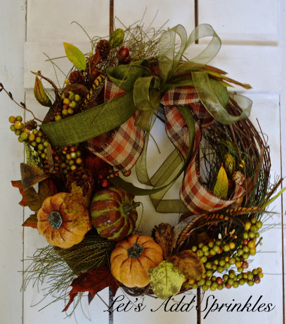 Checked ribbon on a fall wreath