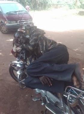 okada rider sleeping on bike