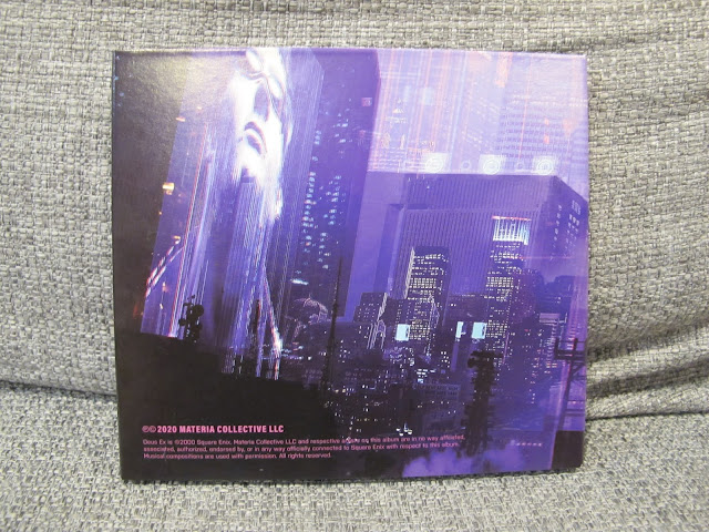 Photo of back cover of CD album for Conspiravision: Deus Ex Remixed