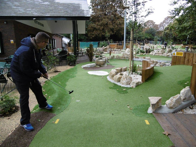 Playing the Putt in the Park Miniature Golf course at Battersea Park in London on Miniature Golf Day 2015