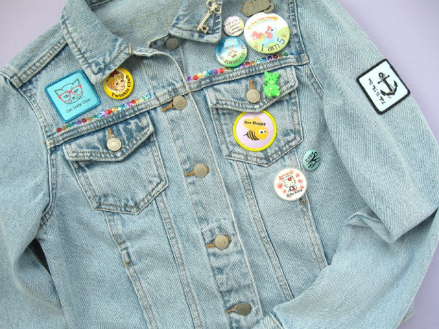 DIY customised denim jacket decorated with badges, sequins & custom patches