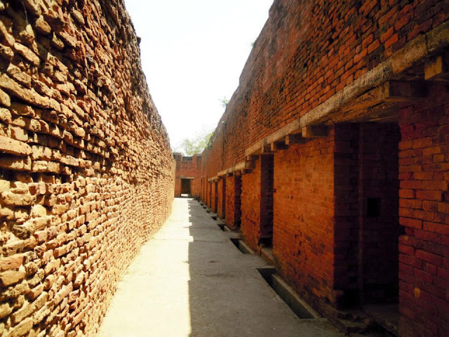 Rows of hostel rooms in Nalanda where the students lived. The Chinese pilgrim Hiuen Tsang who visited India in 637 AD lived in one of these rooms.