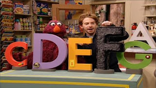 Telly and deliveryman Vinny (Seth Green) glances at the letters. Telly joins the Letter of the Month Club. Sesame Street Preschool is Cool ABCs With Elmo