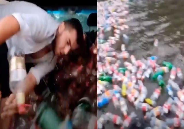 Joven se grabó tirando miles de botellas de plástico a un río (Video);  Podría terminar en prisión