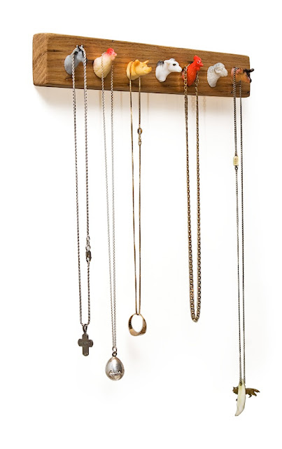 necklace rack with barnyard animal heads as pegs