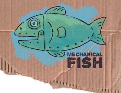 Mechanical fish on cardboard
