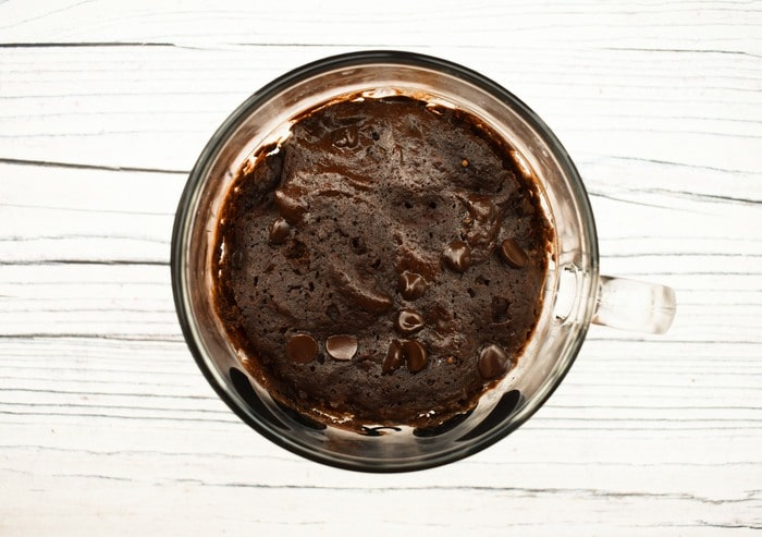 Overview of chocolate brownie mug cake with melted chocolate chips