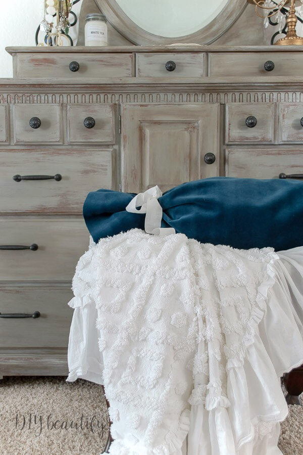 European elegance velvet blue bolster and ruffled chenille throw