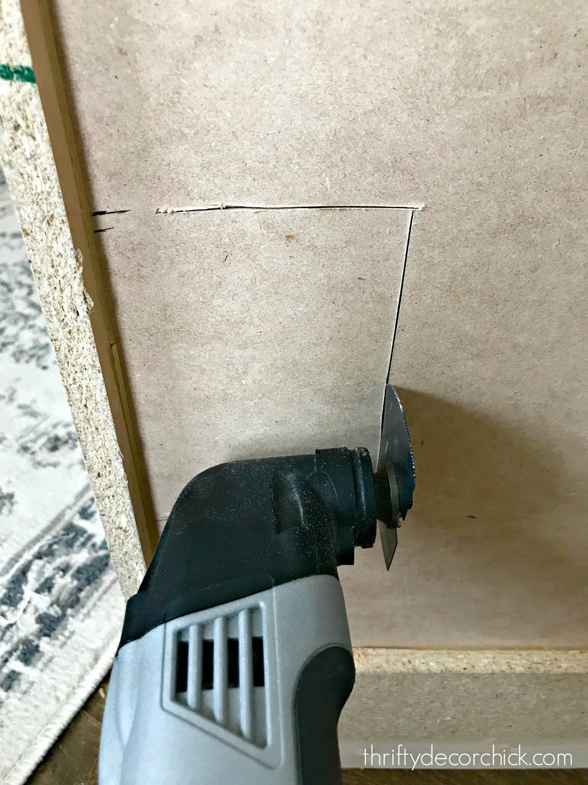 Easily cut holes with Dremel cutting tool