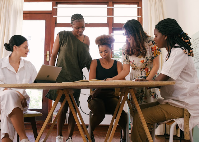 Five women working on a project.