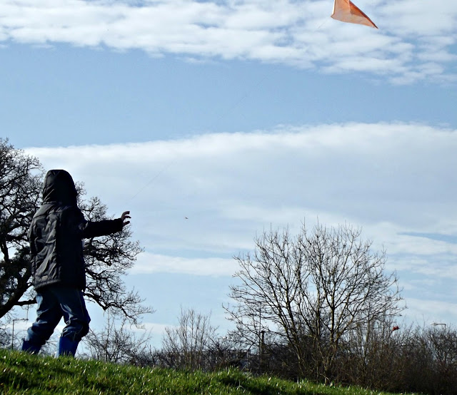 Flying a homemade kite.