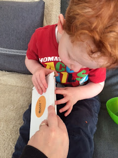 A little boy opening a box