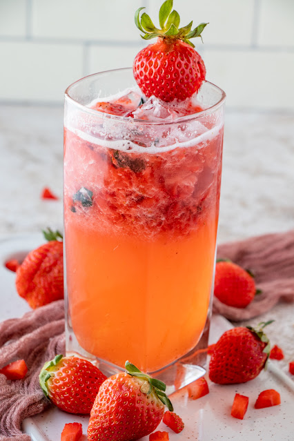 cocktail with strawberries and basil with white background