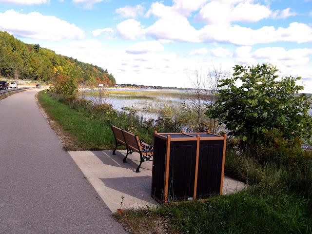 A bench and bin on the Lake Michigan walking path