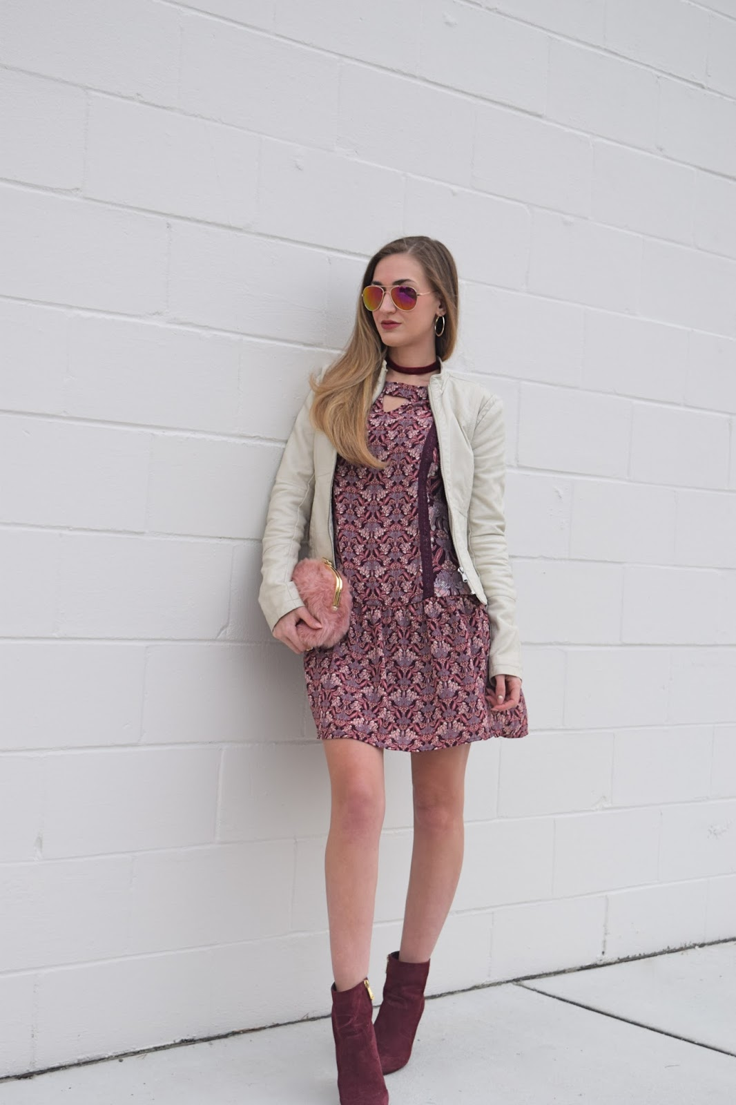 wearing exhilaration printed drop waist dress, cream faux leather moto jacket, who what wear fur mini bag, burgundy suede booties, burgundy velvet choker