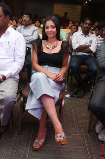 Swetha Basu in a Black Sleeveless Top Long Skirt at Mixture Potlam Movie Audio Launch 037.JPG