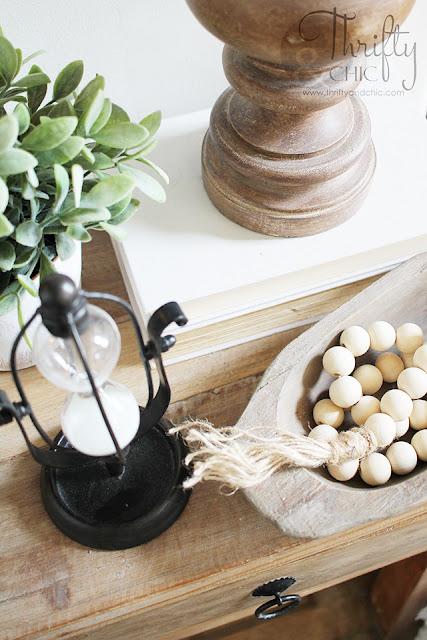 wood bead garland on wood night stand