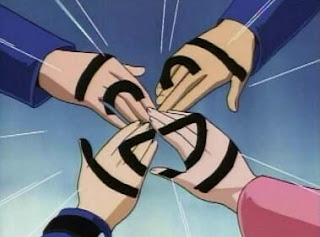 Yu-Gi-Oh friends join hands and create a symbol of their friendship