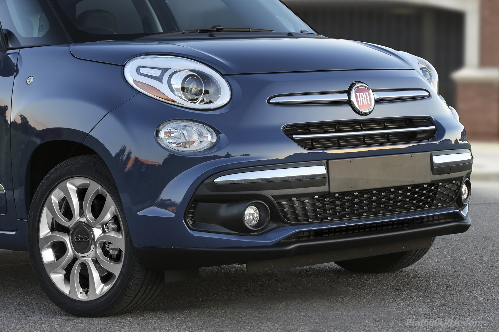 The fiat 500l has been the best selling car in its class since its introduction five years ago the new design features more bright metal and revised trim