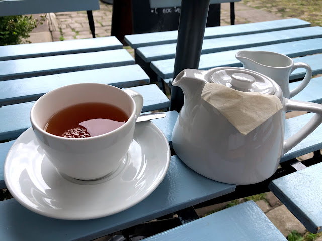 A beautiful cup of tea with a teapot - exactly the right amount of effort