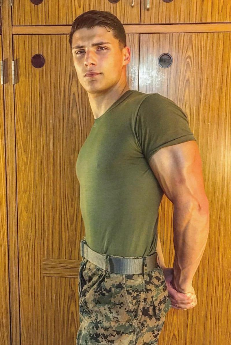 handsome-soldier-green-military-uniform-flexing-muscle-biceps