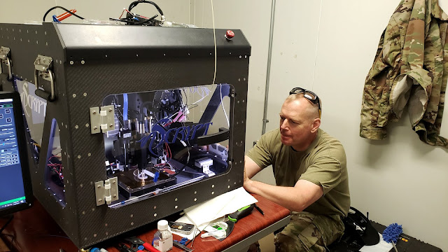 A man works with a 3D printer