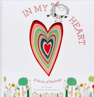 Cover of book In My Heart by Jo Witek with little girl jumping over colorful heart shape dicuts in the center going from large to small