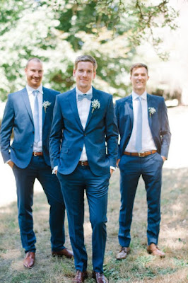 K'Mich Weddings - wedding planning - grooms standing with their hands in their pockets