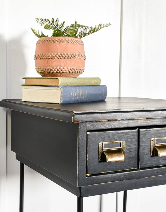 Black painted side table with metal labelholder pulls