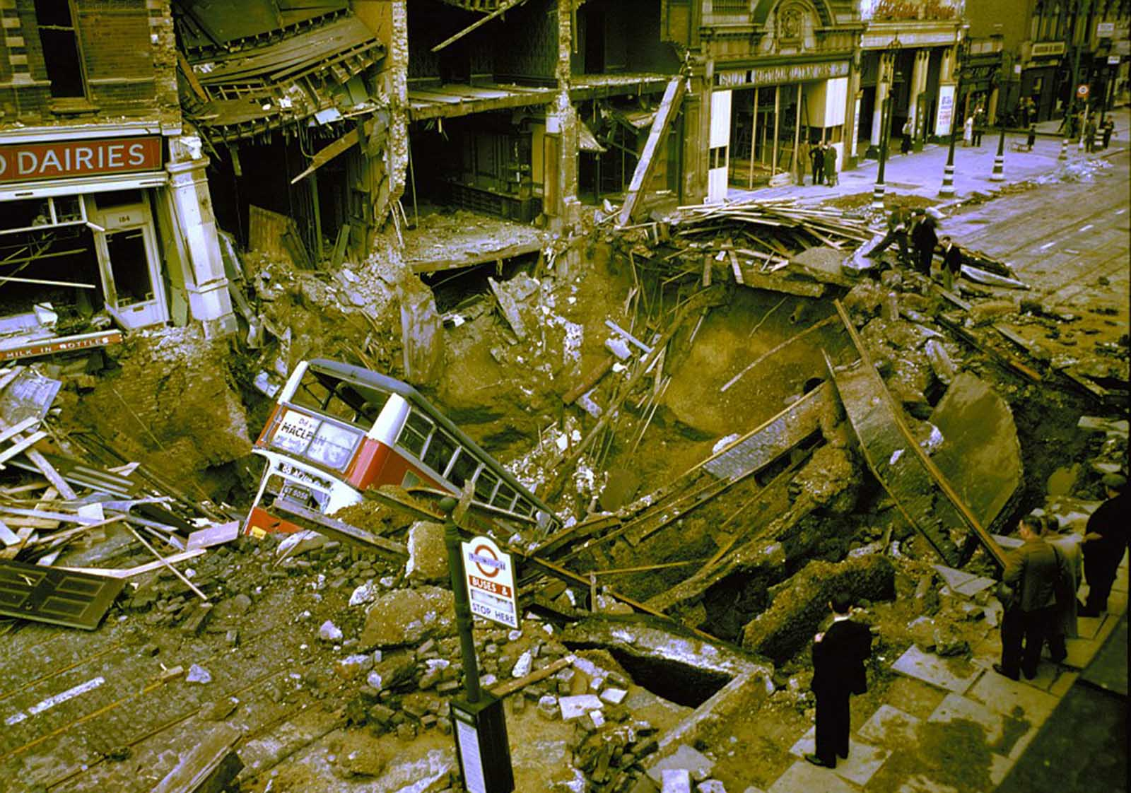A bus in the bomb crater caused by a German air raid on Balham in South London.
