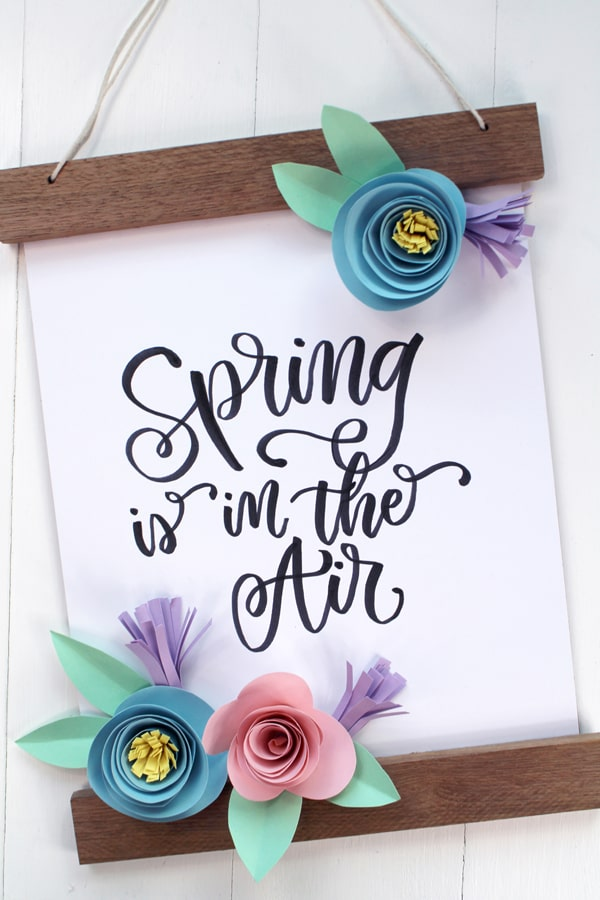 Make a rolled paper flower banner for Spring with pastel cardstock and Tombow adhesive.