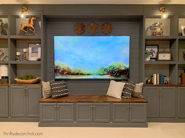 long wall of DIY built ins with TV