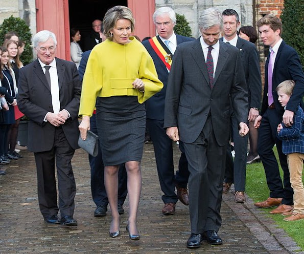Queen Mathilde visited Rumbeke Castle. Queen Mathilde wore NATAN Coat, Gold Diamond earrings