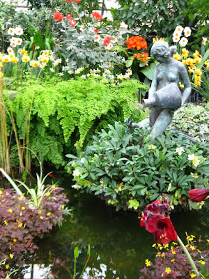 Allan Gardens Conservatory 2012 Spring Flower Show leda statue and swan fountain with hellebores, amaryllis, oxalis by garden muses: a Toronto gardening blog