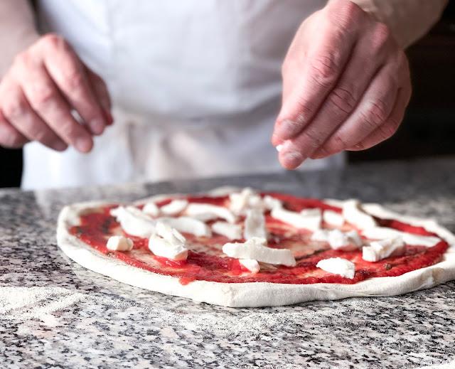 Italian Hertiage Month in Toronto. Chef makes pizza