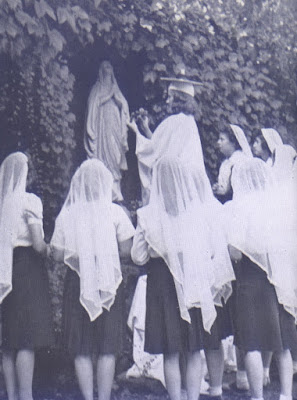 Student crowning Mary statue