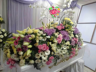 Karangan Bunga Tutup Peti Mati