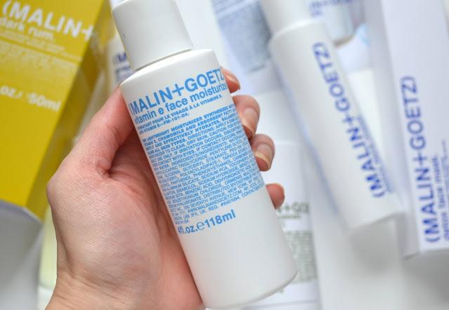 close up of malin and goetz vitamin e moisturizer bottle